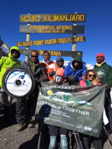Victory for FAISR at the top of Mount Kilimanjaro. (PHOTO CREDIT James Lassner)